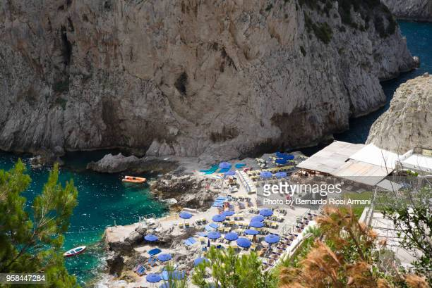 the beach at the faraglioni's feet - capri stock pictures, royalty-free photos & images