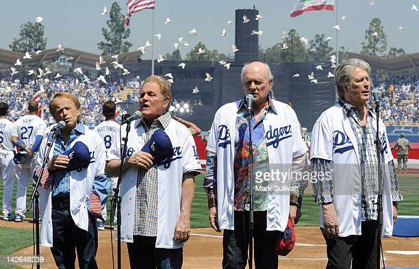 The Beach Boys Al Jardine Bruce Johnston Mike Love and Brian Wilson sing the national anthem during Los Angeles Dodgers opening day at Dodger Stadium...