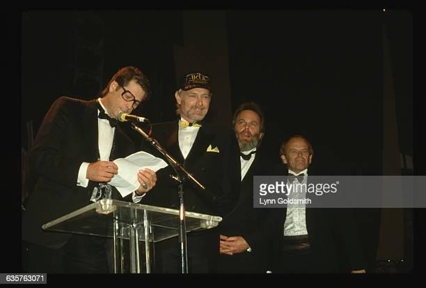 The Beach Boys attend an award ceremony Brian Wilson reads a speech as Mike Love Al Jardine and Carl Wilson stand beside him