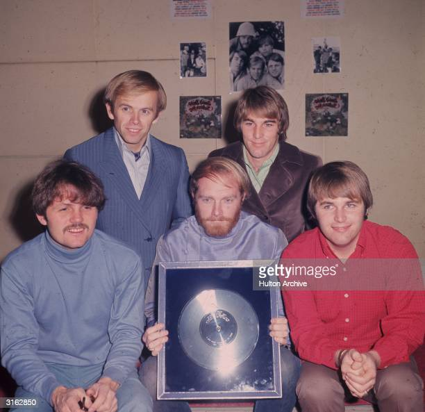 The Beach Boys with their silver disc. Clockwise from l to r; Bruce Johnston, Al Jardine, Mike Love ) Dennis Wilson and bottom right, Carl Wilson ....