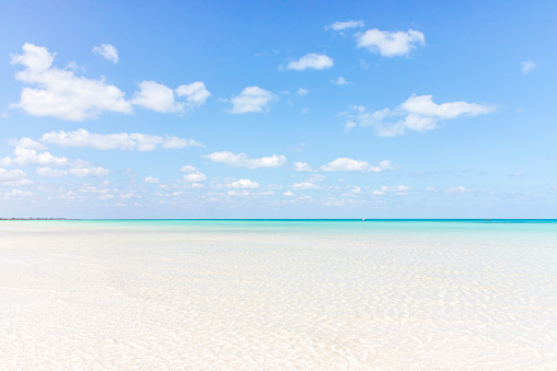 The beach, crystal clear turquoise water and clear blue sky on the Island of Holbox, Mexico - gettyimageskorea