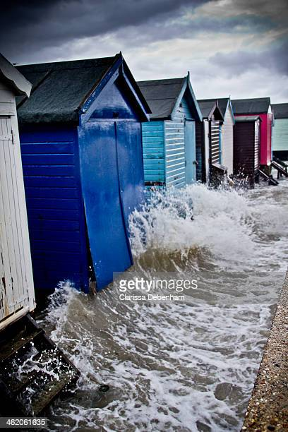 CONTENT] The beach huts on Thorpe Bay Beach Southend on Sea Essex Storms and high tides had combined to raise the level of the River Thames way above...