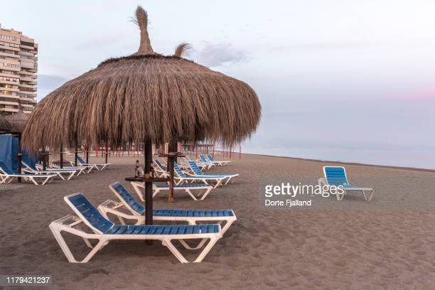 the beach in torremolinos after people have left - dorte fjalland stock pictures, royalty-free photos & images