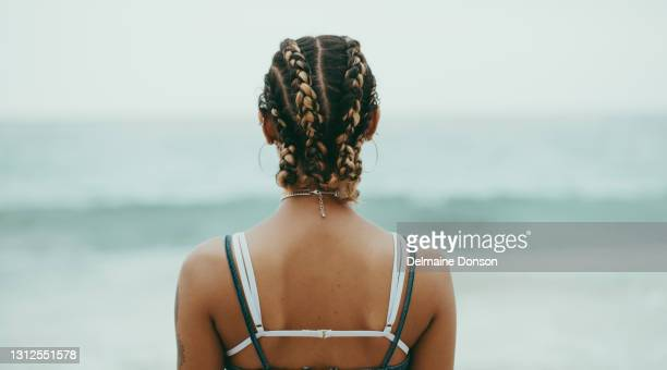 the beach is always a place of peace for me - human back stock pictures, royalty-free photos & images