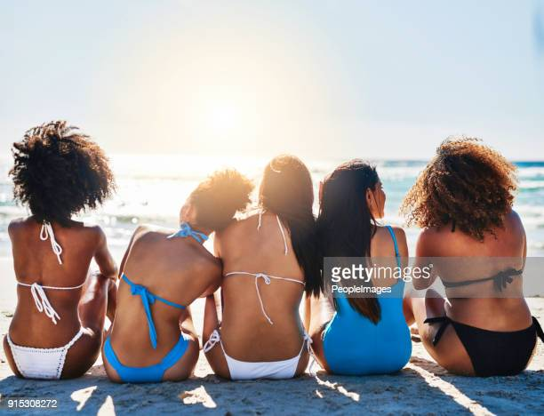 the beach is even better shared with best friends - swimwear stock photos and pictures