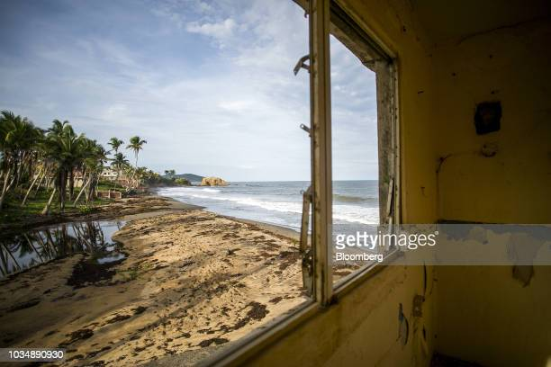 The beach is seen from a home damaged by Hurricane Maria in El Negro, Yabucoa, Puerto Rico, on Monday, Sept. 17, 2018. A year ago Thursday, Hurricane...