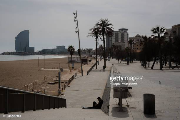 The beach of Barceloneta is seen almost empty on the third working day of the state of alarm in Barcelona on March 18, 2020 in Barcelona, Spain.