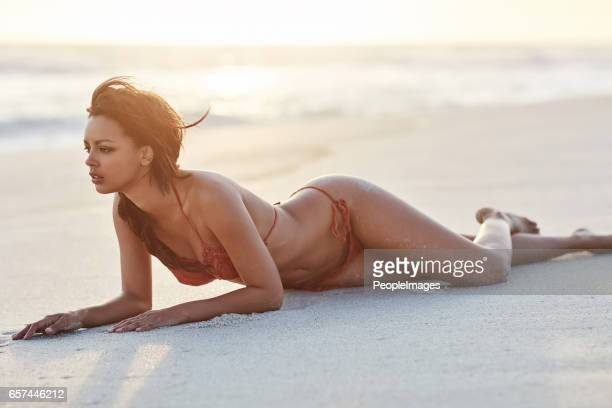 the beach only adds to my sexiness - perfect female body shape stock photos and pictures