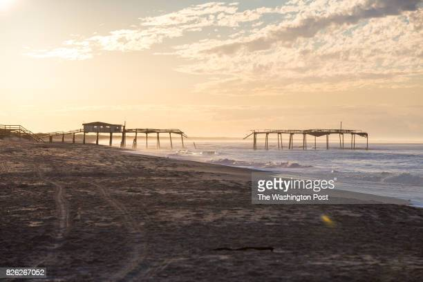 The beach sits empty of a warm sunny morning on Hatteras Island on August 2 2017 Nearly a week earlier a construction company building a new bridge...