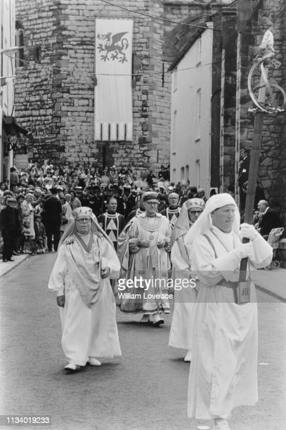The bearer of the Grand Sword leads Druids of the national Gorsedd of Wales in procession at the Investiture of Prince Charles as Prince of Wales at...