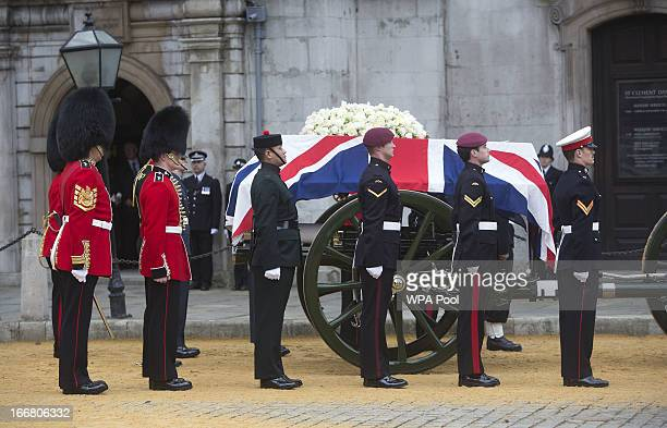 The Bearer Party made up of personnel from the three branches of the military transfer the coffin of British former Prime Minister Margaret Thatcher...