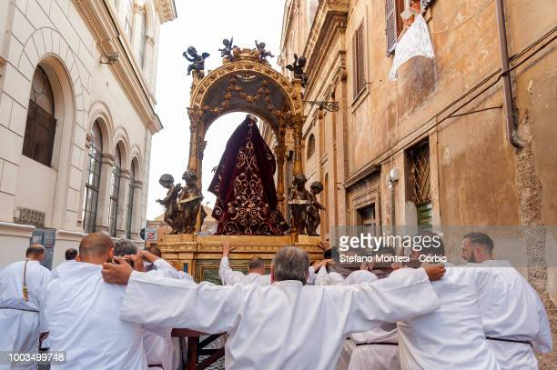 The bearers carry the statue for the Solemn celebrations and procession in honor of Madonna del Carmine Our Lady of Roman Citizens called 'de...