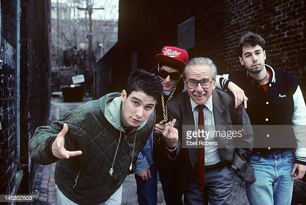 The Beastie Boys pose for a group portrait with an unknown man in Worcester Massachusetts on April 9 1987 LR AdRock Mike D unknown MCA