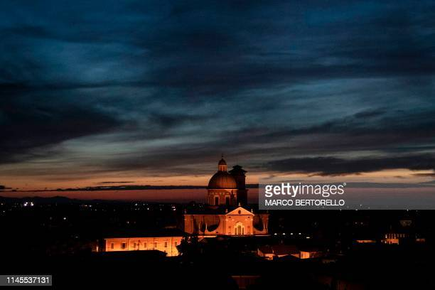 The Beata Vergine della Ghiara Church is pictured at the sunset on May 15, 2019 Northern Italy. - The Unione Campanari Reggiani is a group of people...