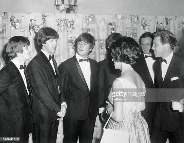 The Beatle Meet Royalty. London: Princess Margaret and her husband Lord Snowdon have the popular singing group The Beatles presented to them at the...