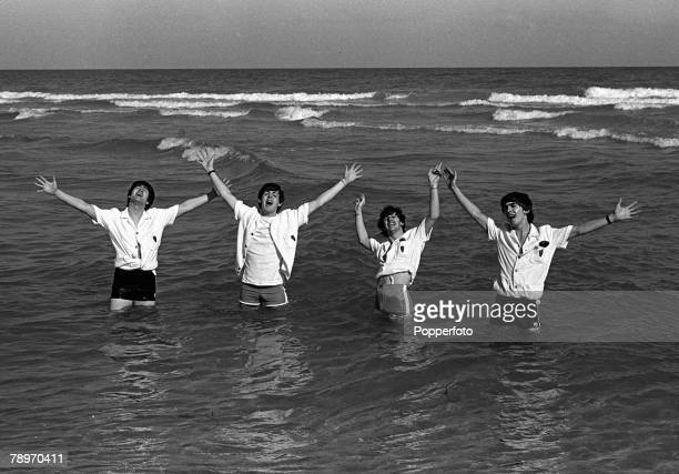 The Beatles 1964 US Tour 15th February Members of the British pop group The Beatles pose in the sea at Miami Beach during the bands tour of America...