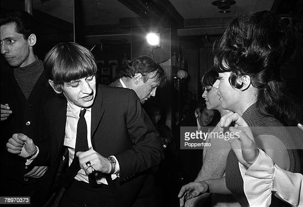 The Beatles 1964 US Tour Beatles drummer Ringo Starr on the dance floor with a girl as The Beatles attend a party at the Peppermint Lounge during the...