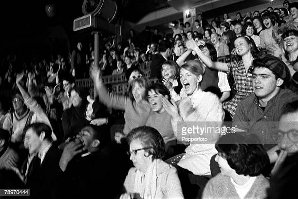 The Beatles 1964 US Tour Enthusiastic American music fans gripped by Beatlemania screaming out as the band play in concert at Carnengie Hall in New...