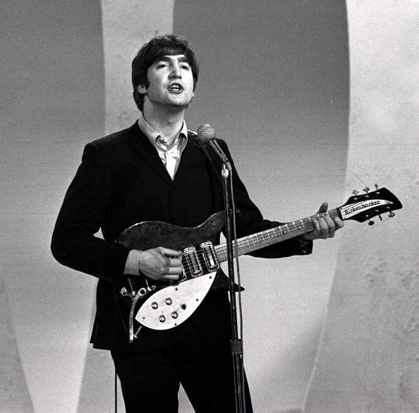 John Lennon Of The British Pop Group Beatles Playing Guitar And Singing During Band S Tour USA