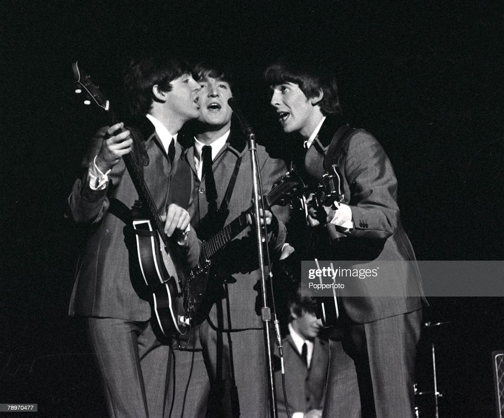 Paul McCartney John Lennon And George Harrison Share A Microphone As They Sing Song