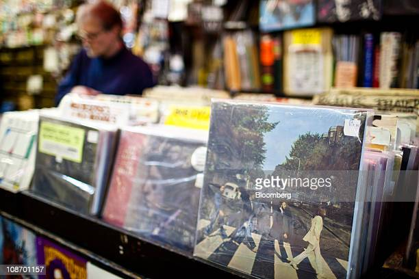 The Beatles 'Abbey Road' album is displayed for sale while a customer browses at Bleeker Bob's record shop in New York US on Tuesday Feb 1 2011 EMI...