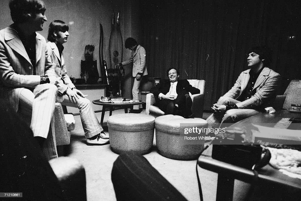 The Beatles and manager Brian Epstein relaxing after their third Nippon Budokan show in Hotel Suite 1005 at the Tokyo Hilton.