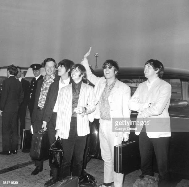 The Beatles and their manager Brian Epstein arrive back in London from Manila after their tour of Germany, Japan and the Philippines, 8th July 1966.