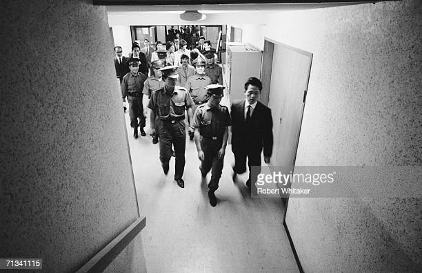 The Beatles and their security approach the stage area of the Budokan Hall Tokyo Japan 2nd July 1966