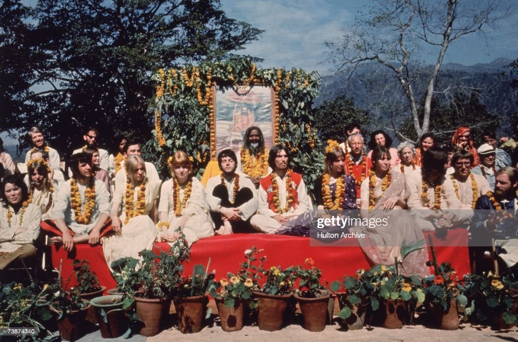The Beatles and their wives at the Rishikesh in India with the Maharishi Mahesh Yogi, March 1968. The group includes Ringo Starr, Maureen Starkey, Jane Asher, Paul McCartney, George Harrison (1943 - 2001), Patti Boyd, Cynthia Lennon, John Lennon (1940 - 1980), Beatles roadie Mal Evans, Prudence Farrow, Jenny Boyd and Beach Boy Mike Love.
