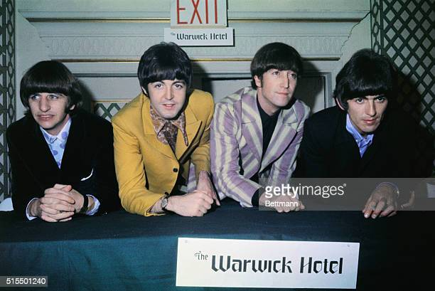The Beatles are shown at a press conference at the Warwick Hotel. Standing left to right are: Ringo Starr, , Paul McCartney, John Lennon, and George...