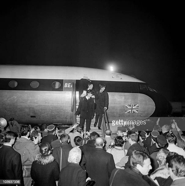 The Beatles arrive 15 January 1964 in France at the Bourget airport near Paris to perform their first series of concerts outside of Britain