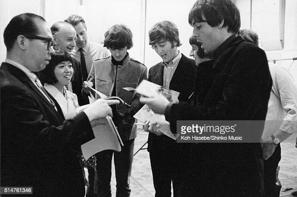 The Beatles at EMI Studios Abbey Road London during the recording session for 'It's Only Love' June 15 1965 Left to right Joe Miyasaki Rumi Hoshika...