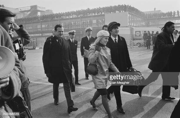 The Beatles at London Airport en route to America 13th February 1964 Pictured are John Lennon and his wife Cynthia Lennon with manager Brian Epstein