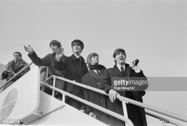 The Beatles at London Airport en route to America 13th February 1964 From left to right a photographer George Harrison John Lennon Ringo Starr and...