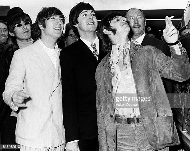 The Beatles at London Airport in 1966 before leaving for a tour of Germany and Japan