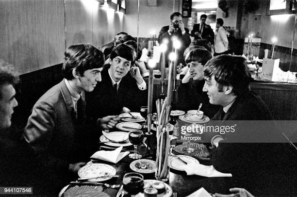 The Beatles at lunch London Left to Right Road Manager Neil Aspinall in the bottom left corner then George Harrison Paul McCartney Ringo Starr and...