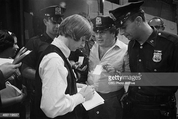 The Beatles at rehearsal for their final performance on THE ED SULLIVAN SHOW. Image dated August 14, 1965. Shown is Ringo Starr signing an autograph...