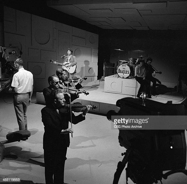 The Beatles at rehearsal for their final performance on THE ED SULLIVAN SHOW. Image dated August 14, 1965. Paul McCartney playing with violins while...