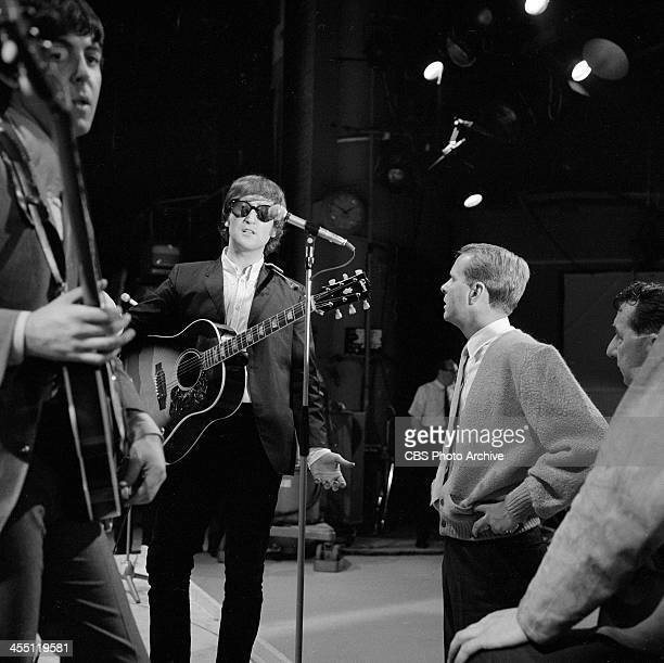 The Beatles at rehearsal for their final performance on THE ED SULLIVAN SHOW. Image dated August 14, 1965. From left: Paul McCartney and John Lennon .