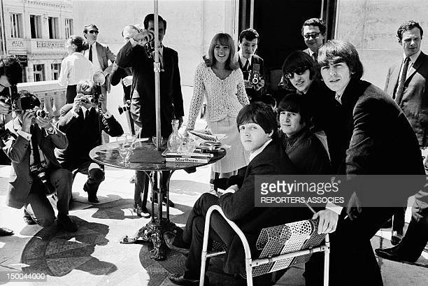 The Beatles at their Paris hotel on June 20 1965 in Paris France