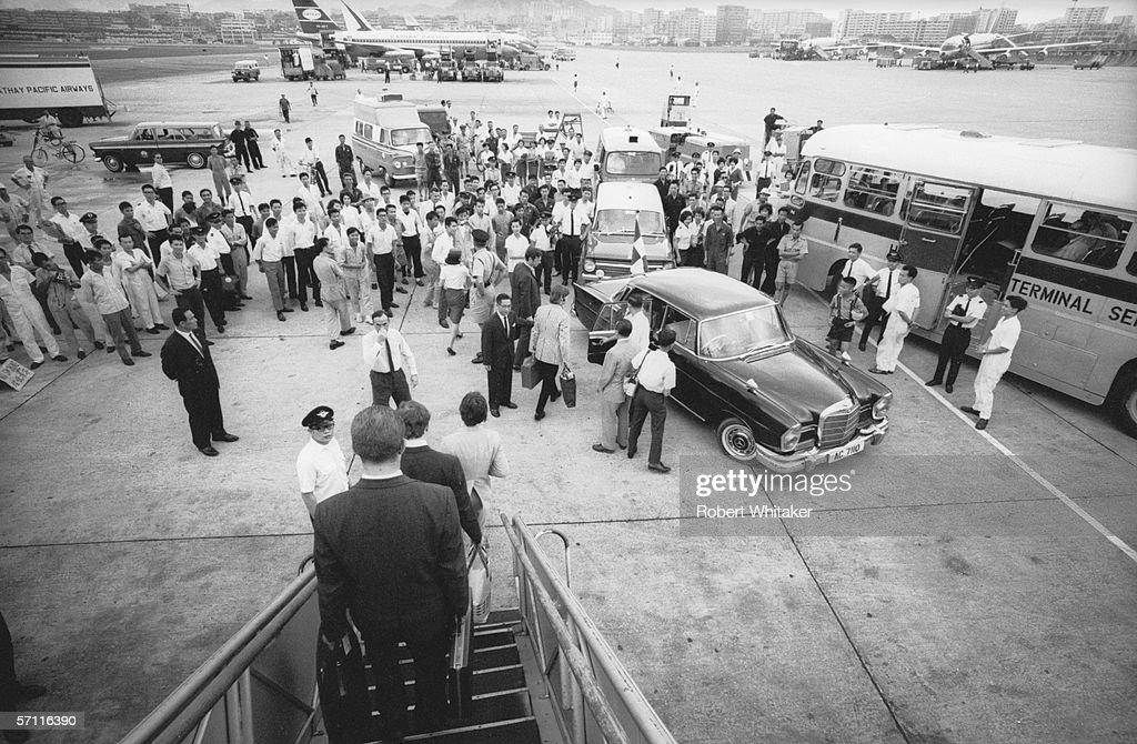 The Beatles disembark at Hong Kong International Airport (Kai Tak Airport) during their Asian tour, 3rd July 1966. Their aircraft stopped there to refuel before taking them on to the Philippines.