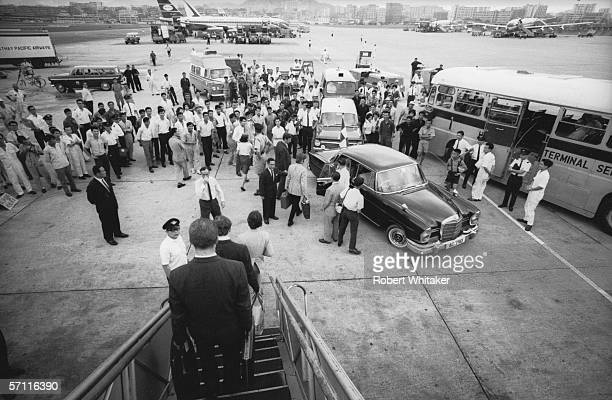 The Beatles disembark at Hong Kong International Airport during their Asian tour 3rd July 1966 Their aircraft stopped there to refuel before taking...
