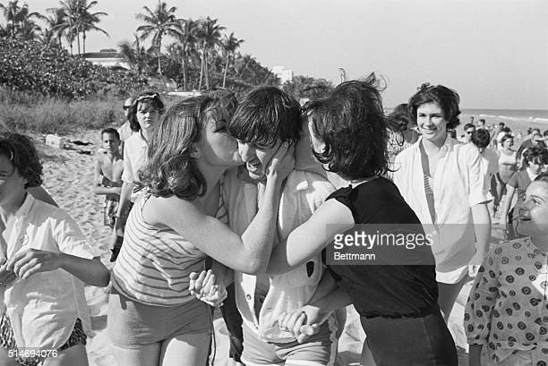 The Beatles drummer Ringo Starr gets kisses from excited fans when he spends a day at Miami Beach Florida
