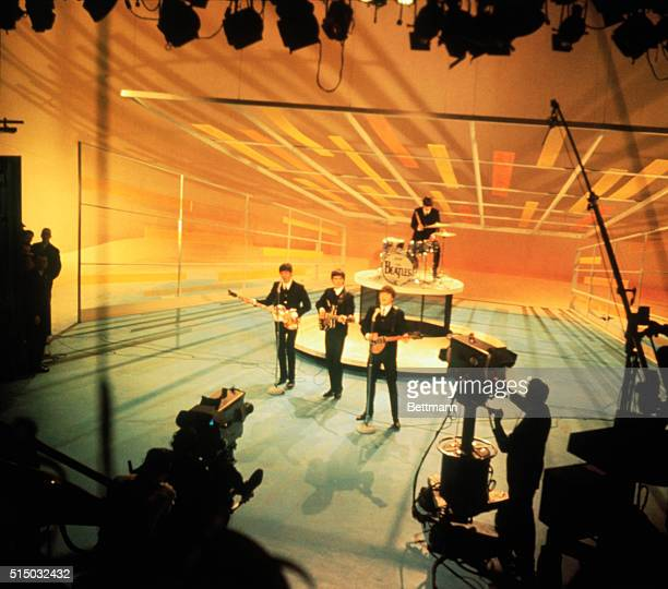 The Beatles during a performance taping for the Ed Sullivan Show in 1964.