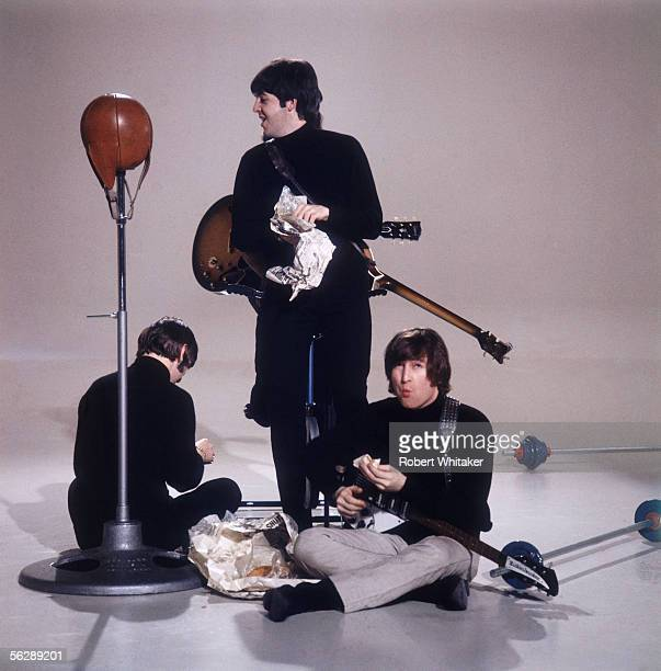 The Beatles eat fish and chips during the making of a promotional film for their single 'I Feel Fine' February 1966 Left to right John Lennon Paul...
