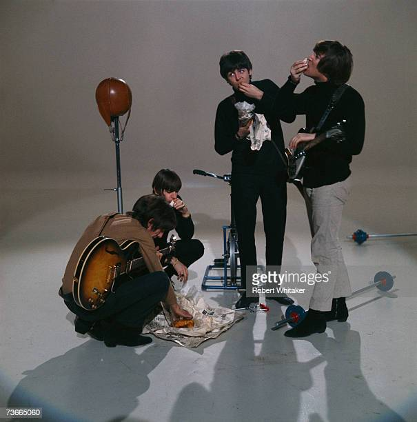 The Beatles eat fish and chips during the making of a promotional film for their single 'I Feel Fine' November 1965 Left to right George Harrison...