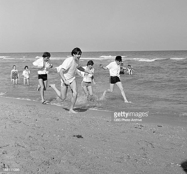 The Beatles enjoy the sun at Miami Beach Florida The Band was in Florida to appear on THE ED SULLIVAN SHOW at the Deauville Hotel From left George...