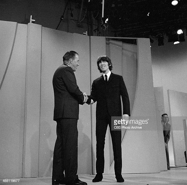 The Beatles final performance on THE ED SULLIVAN SHOW. Image dated August 14, 1965. Ed Sullivan is shown here with George Harrison.