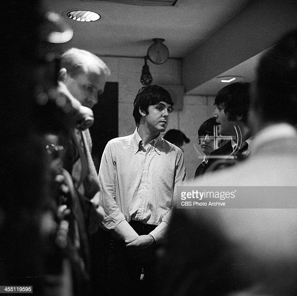 The Beatles final performance on THE ED SULLIVAN SHOW. Image dated August 14, 1965. Paul McCartney, center, talking to John Lennon with Ringo Starr...