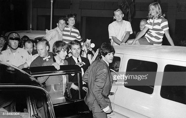The Beatles foiled in a plan to whisk them into the Hotel Sahara through a freight entrance alight from their limousine prepared to do battle with a...
